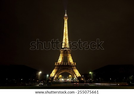 PARIS - JANUARY 30, 2015: Illuminated Eiffel tower at night on January 30, 2015 in Paris. The Eiffel tower is the most visited monument of France. - stock photo