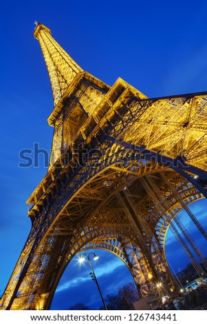 PARIS - JANUARY 01: The Eiffel tower on January 01, 2013 at night in Paris, France. Erected in 1889 as the entrance arch to the 1889 World's Fair, it has become a global cultural icon of France. - stock photo