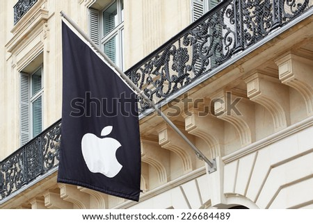 PARIS - JULY 6: Apple logo on black flag in Paris Apple store, on July 6, 2014 in Paris. Apple Inc. is an American corporation with headquarter in Cupertino, California. - stock photo