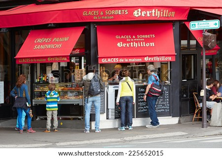 PARIS - JULY 5: Berthillon ice cream shop with people. Is one of the most famous ice cream and crepes parlor of the french capital on July 5, 2014 in Paris.  - stock photo