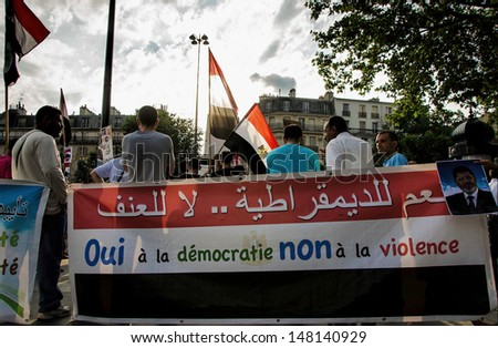 PARIS - JULY 26 - Demonstrators gather at Place de la Bastille to protest the Egyptian military government's July 3rd overthrow of President Mohamed Morsi, on July 26, 2013 in Paris. - stock photo