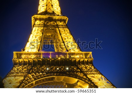 PARIS - JULY 20 : Eiffel tower at night on July 20, 2010 in Paris. The Eiffel tower is the most visited monument of France.