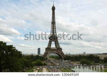 PARIS - JULY 22: Eiffel tower from Trocadero on July 22, 2009 in Paris, France. The Eiffel tower is the most visited monument of France with over 6 million visitors a year, built in 1889. - stock photo