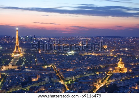PARIS - JULY 20 : Eiffel tower, hotel de  at night on July 20, 2010 in Paris. The Eiffel tower is the most visited monument of France. Cityscape with eiffel tower, invalides and arch de triomphe - stock photo