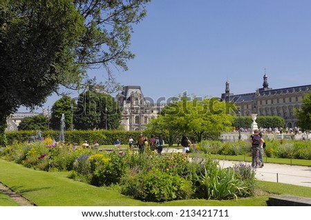 PARIS - JULY 3, 2014: Famous Tuileries garden (Jardin des Tuileries). Beautiful and popular public garden located between the Louvre Museum and the Place de la Concorde. Paris, France.