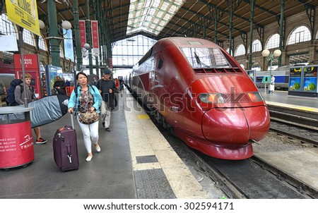 PARIS - JULY 19: French THALYS-train at Paris North Railway Station on July 19, 2015 in Paris, France. THALYS is France's flagship high speed train with possible maximum speed of over 400 km per hour. - stock photo