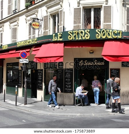 PARIS - JULY 22: Le Sans Souci cafe on July 22, 2011 in Paris, France. Le Sans Souci cafe is a typical establishment for Paris, one of largest metropolitan areas in Europe. - stock photo