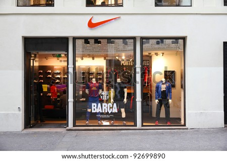 PARIS - JULY 20: Nike store on July 20, 2011 in Paris, France. Nike is one of most recognized sports fashion brands worldwide. It exists since 1964 and had US$ 19 billion revenue (2010). - stock photo