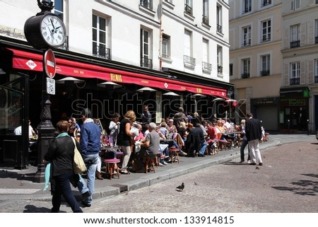 PARIS - JULY 24: People visit Cafe Delmas on July 24, 2011 in Paris, France. Delmas cafe is a typical establishment for Paris, one of largest metropolitan areas in Europe. - stock photo