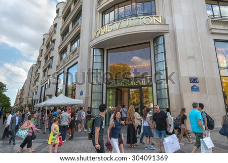 PARIS - JULY 20: people waiting  in front of Louis Vuitton store on July 20, 2015 in Paris, France. The company is one of the world's leading fashion houses with more than 460 stores worldwide. - stock photo