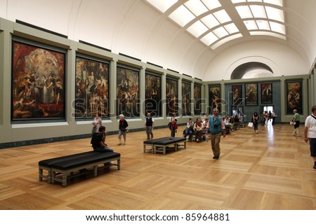 PARIS - JULY 22: Rubens paintings on July 22, 2011 in Louvre Museum, Paris, France. With 8,5m annual visitors, Louvre is consistently the most visited museum worldwide. - stock photo