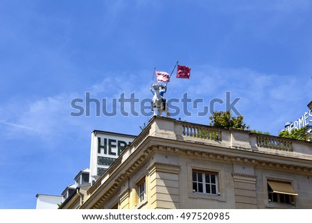 PARIS - JULY, 2016: Statue on the top of famous fashion brand's building on Rue Saint Honore in Paris on July 10, 2016.