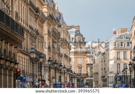 PARIS, JULY 20, 2014: Tourists along city streets. More than 30 million people visit Paris every year.