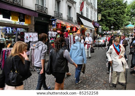 PARIS - JULY 22: Tourists at Rue de Steinkerque on July 22, 2011 in Paris, France. The street is one of most famous shopping areas in Monmartre district. Paris is the most visited city worldwide. - stock photo