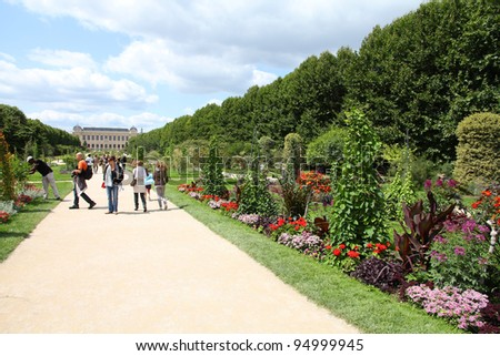 PARIS - JULY 24: Tourists stroll in Garden of Plants on July 24, 2011 in Paris, France. Garden of Plants is popular among tourists in Paris, the most visited city worldwide. - stock photo