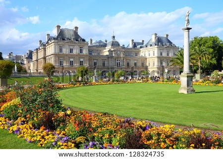 PARIS - JULY 23: Tourists stroll in Luxembourg Gardens on July 23, 2011 in Paris, France. Luxembourg area is popular among tourists in Paris, the most visited city worldwide. - stock photo