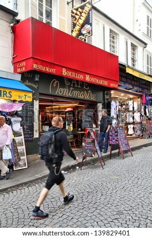 PARIS - JULY 22: Tourists visit Rue de Steinkerque on July 22, 2011 in Paris, France. The street is one of most famous shopping areas in Monmartre district. Paris is the most visited city worldwide. - stock photo
