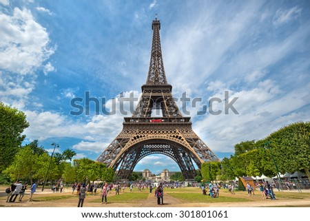 PARIS - JULY 20: tourists visit the Eiffel Tower on July 20, 2015 in Paris, France. In year 2014 more than 15 million tourists visited the city of Paris.  - stock photo