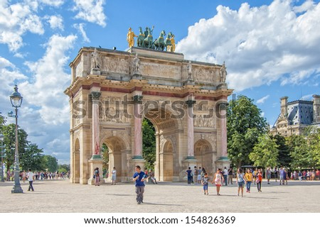 PARIS - JULY 20:Triumphal Arch (Arc de Triomphe du Carrousel) at Tuileries gardens in Paris, France on July 20, 2013. Monument was built between 1806-1808 to commemorate Napoleon's military victories.