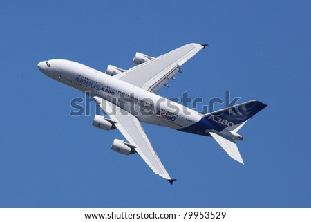 PARIS - JUN 26: Airbus A380 (largest passenger airliner in the world) on 49th Paris Air Show on June 26, 2011 in Paris, France. - stock photo