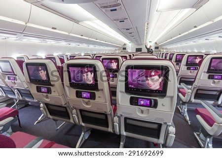 PARIS - JUN 18, 2015: Cabin view of a Qatar Airways Airbus A350. Qatar Airways is the first user of the A350 with it's first flight on 15 January 2015.