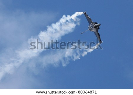 PARIS - JUN 23: Dassault Rafale during a acrobatic flight 49th Paris Air Show on June 23, 2011 in Paris, France.