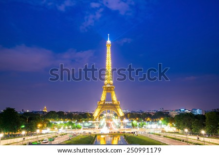 Paris - Jun 25: Eiffel Tower Light and Beam Performance Show at Dusk on Jun 25, 2014. Eiffel Tower is the highest monument in France use 20,000 light bulbs in the show.