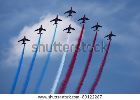PARIS - JUN 26: Patrouille Acrobatique de France, the precision aerobatic demonstration team of the French Air Force with Donier Alphajets on 49th Paris Air Show on June 26, 2011 in Paris, France.