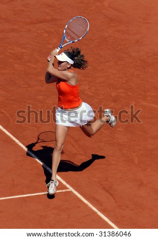 PARIS - JUNE 1: Agnieszka Radwanska of Poland in action at French Open, Roland Garros on June 1, 2009 in Paris, France. - stock photo