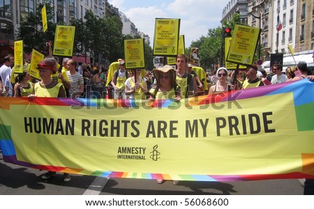 PARIS - JUNE 26: Amnesty International march in the Paris Gay Pride parade to support gay rights, on June 26, 2010 in Paris, France. - stock photo