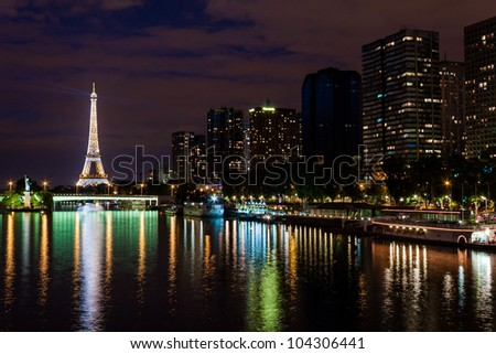 PARIS - JUNE 11: Cityscape of Paris, France with Eiffel Tower at night on June 11, 2011. The Eiffel tower is the most visited monument of France with about 6 million visitors every year. - stock photo