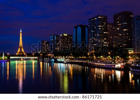PARIS - JUNE 11: Cityscape of Paris with Eiffel Tower at night on June 11, 2011. The Eiffel tower is the most visited monument of France with about 6 million visitors every year. - stock photo