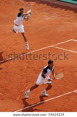 PARIS - JUNE 05: Daniel NESTOR (L) of Canada and Nenad ZIMONJIC (R) of Serbia during the men's doubles final match of the French Open at Roland Garros on June 05, 2010 in Paris, France. - stock photo