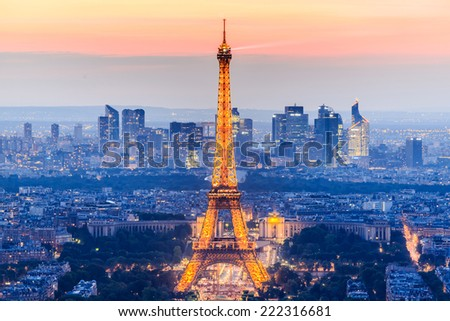 PARIS - JUNE 20: Eiffel Tower brightly illuminated at dusk on JUNE 20, 2014 in Paris. The Eiffel tower is the most visited monument of France. - stock photo