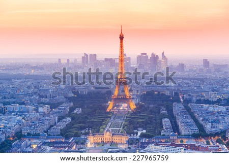 PARIS - JUNE 20: Eiffel Tower brightly illuminated at dusk on JUNE 20, 2014 in Paris. The Eiffel tower is the most visited monument of France.