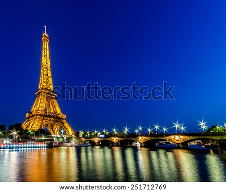 PARIS - JUNE 15: Eiffel Tower on June 15, 2012 in Paris. Eiffel tower is one the most popular attractions in Paris - stock photo