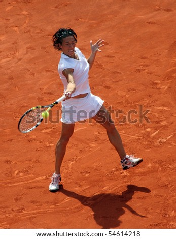 PARIS - JUNE 05: Francesca SCHIAVONE of Italy in action during the women's singles final match of the French Open at Roland Garros on June 5, 2010 in Paris, France. - stock photo