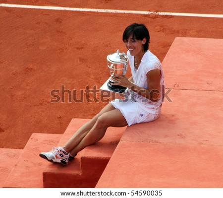 PARIS - JUNE 05: Francesca SCHIAVONE of Italy poses with her trophy after winning the women's singles final match of the French Open at Roland Garros on June 5, 2010 in Paris, France. - stock photo
