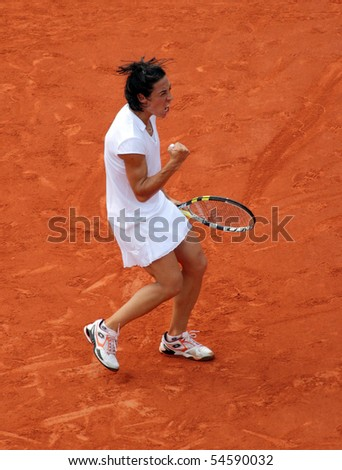PARIS - JUNE 05: Francesca SCHIAVONE of Italy reacts after winning a decisive point during the women's singles final match of the French Open at Roland Garros on June 5, 2010 in Paris, France. - stock photo