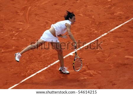 PARIS - JUNE 05: Francesca SCHIAVONE of Italy serves during the women's singles final match of the French Open at Roland Garros on June 5, 2010 in Paris, France. - stock photo
