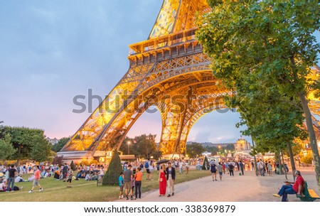 PARIS - JUNE 11, 2014: Illuminated Eiffel Tower at night. La Tour Eiffel is the most visited landmark in France. - stock photo