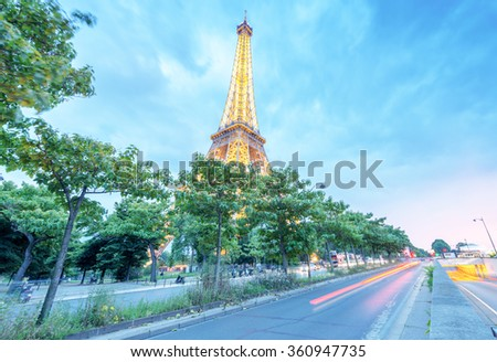PARIS - JUNE 11, 2014: Lights of Eiffel Tower at night. Eiffel  Tower is the most visited landmark in France. - stock photo