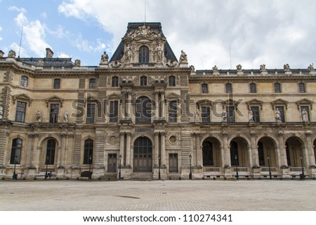 PARIS - JUNE 7: Louvre building on June 7, 2012 in Louvre Museum, Paris, France. With 8.5m annual visitors, Louvre is consistently the most visited museum worldwide. - stock photo