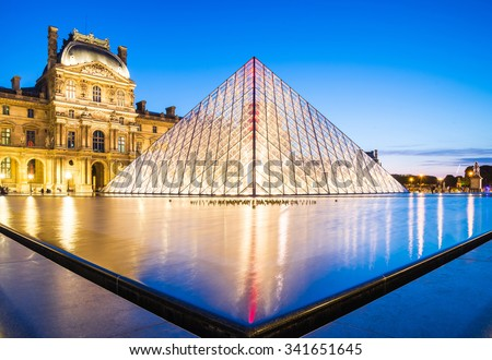 Paris - June 18: Louvre museum at dusk on June 18, 2014 in Paris. This is one of the most popular tourist destinations in France displayed over 60,000 square meters of exhibition space