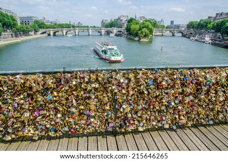 PARIS - JUNE 16  2014 - Love Padlocks at Pont des Arts in Paris on June 16, 2014. - stock photo