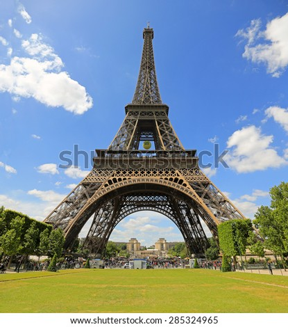 PARIS - JUNE: On June 1, 2015, in Paris, France, the Eiffel Tower sports a hanging tennis ball in support of the French Open tennis tournament. - stock photo