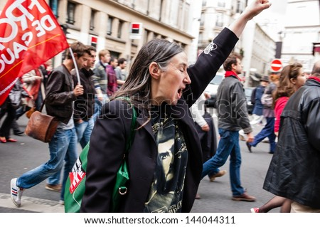 PARIS - JUNE 23:  People march in the streets of Paris in anti fascist protest following death of leftist activist Clement Mericas after attack by skinheads as seen on June 23, 2013 in Paris, France. - stock photo