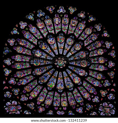PARIS - JUNE 08: Rose window of Notre Dame Cathedral on June 08, 2010 in Paris, France. Notre Dame cathedral dates back to 1250 and is a famous landmark of Paris. - stock photo