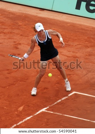 PARIS - JUNE 05: Samantha STOSUR of Australia returns the ball during the women's singles final match of the French Open at Roland Garros on June 5, 2010 in Paris, France. - stock photo