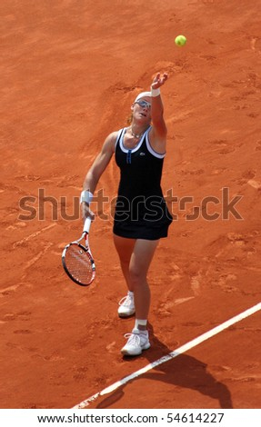 PARIS - JUNE 05: Samantha STOSUR of Australia serves during the women's singles final match of the French Open at Roland Garros on June 5, 2010 in Paris, France. - stock photo
